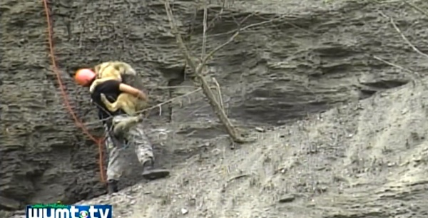 Amazing Photos: Firefighter Rappels Down 200-Foot Cliff to Save a Dog