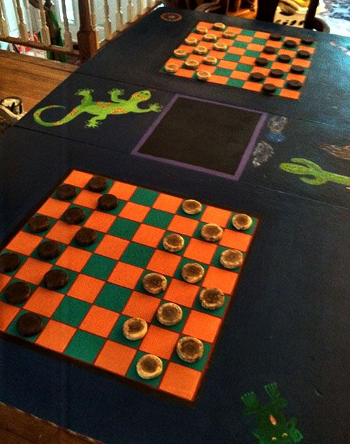 Removable center leaf has a chalkboard scoreboard. Loved giving this old table a new life as a Southwestern Games table!
