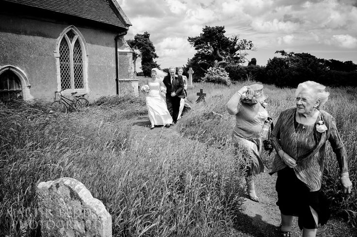 windy arrival at a Suffolk wedding