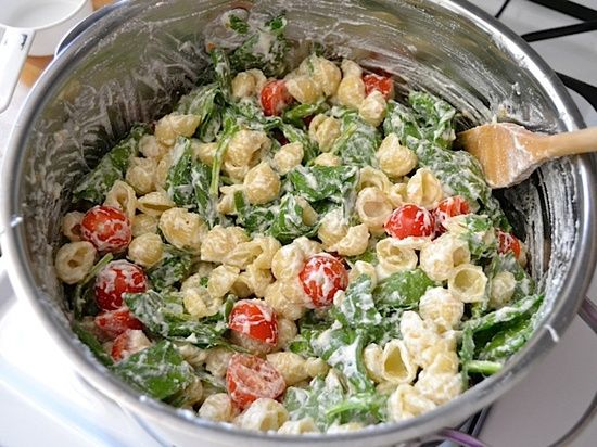 Spinach, ricotta, cherry tomato, garlic + pasta shells. So easy & yummy!