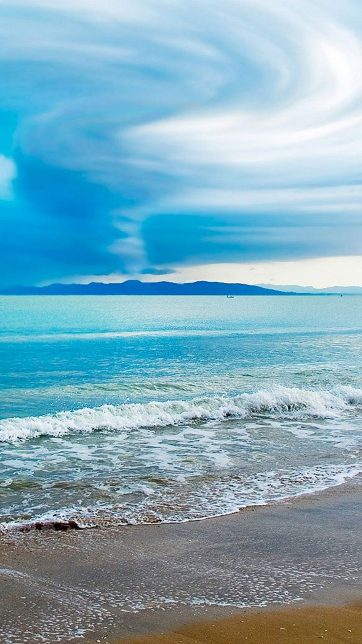 Turquoise Beach, Clouds, And Distant Mountains!