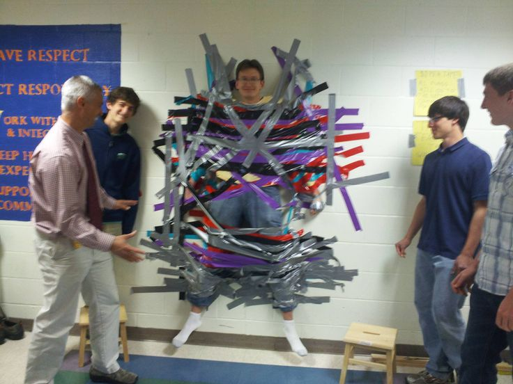fundraising idea??? LOL  How my high school raises money (one dollar a per piece of tape) OMG WE DID THIS!!! :D We should do this again this year but have the students vote for which teacher they want to be taped up to get even MORE $$$ besides just charging per strip of tape!
