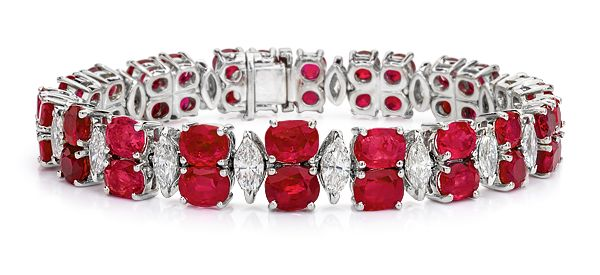 Cellini Jewelers Burma Ruby & Diamond Bracelet 21.35 carats of Oval rubies in a double row, spaced with marquise-cut diamonds, in 18-karat white gold.
