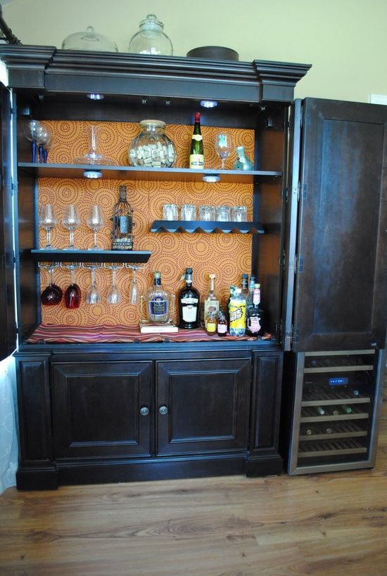 Armoire Turned Bar Storage-lights, shelves with wine glass holders, wallpaper