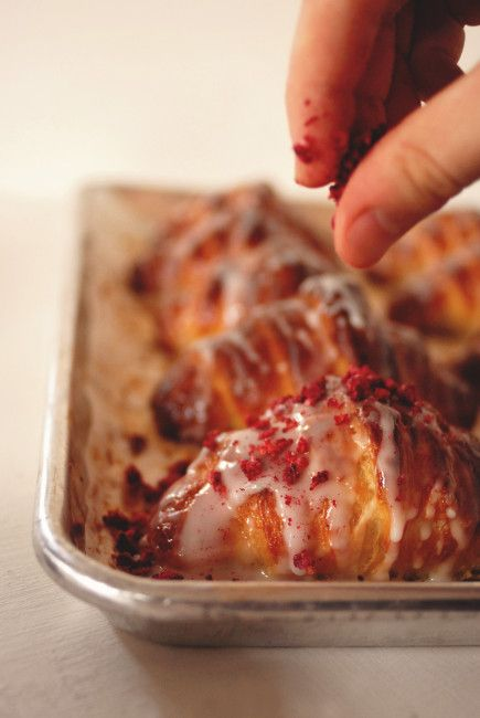 Ispahan croissants filled with rose-scented almond paste & raspberry-lychee gelée, and glazed with rose icing & crunchy freeze-dried raspberries