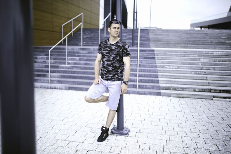 Urban-military look from Bolf. Grey shorts are extremely comfortable and a camo-patterned V-neck T-shirt is just eye-catching. Accesorries like sunglasses, a watch and trendy sneakers provides this styling with an extra flair.