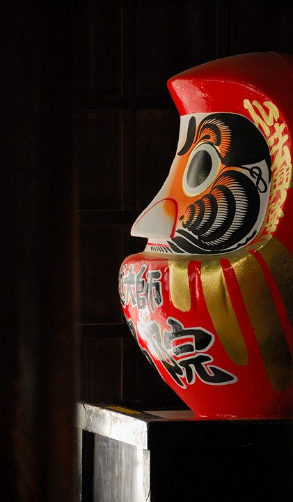 Special traditional Daruma object inside a Tokyo shrine. Photography by Andy Drake on Flickr