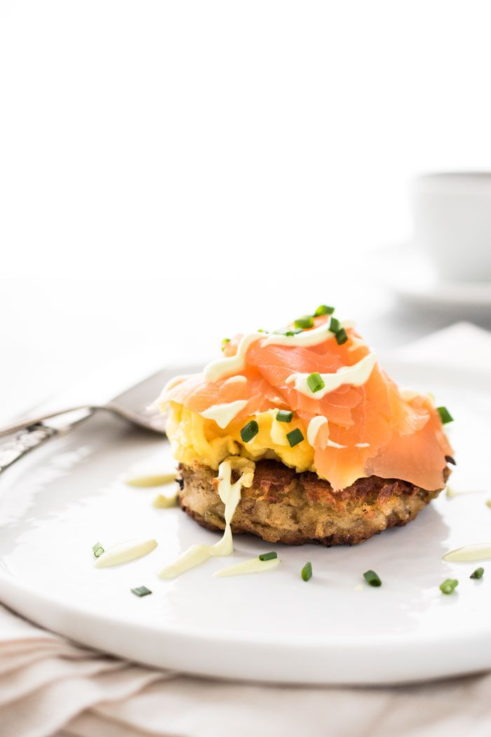 Boxty (Irish potato pancakes) with smoked salmon, creamy scrambled eggs, and drizzled with an avocado crème fraîche sauce. Breakfast is served.