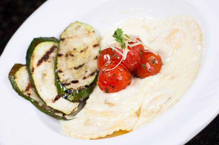 Longwood Lobster Ravioli with grilled zucchini and tomatoes.