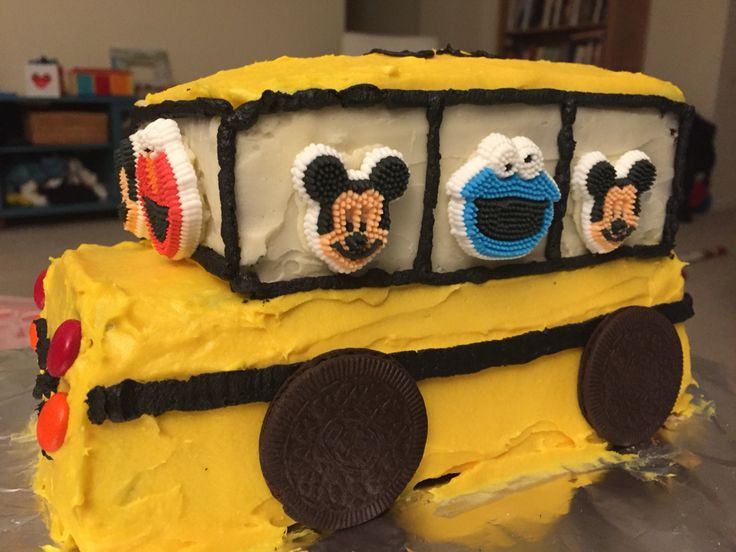 3D school bus birthday cake with Mickey Mouse and Elmo