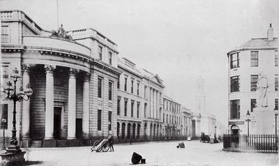 Post 1842-Castlegate facing King Street. Archibald Simpson's North of Scotland Bank, which would become the Clydesdale Bank and later converted into a bar and restaurant. The foundation stone was laid on January 20th 1840 and this majestic building with its giant corinthian columns opened on October 31st 1842. Above the corner portico sits the terracotta sculpture of Ceres, goddess of plenty, designed by James Giles.