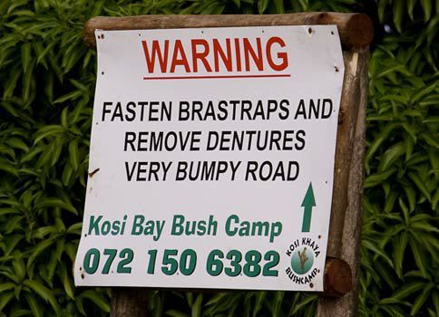 """Fasten your """"Bra-straps"""" ladies, bumpy road ahead! If you have dentures, please remove them too...LOL! (Signs in Africa)."""