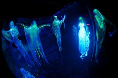 Skeletons with cheese cloth in black light