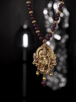Indian Jewellery and Clothing: Antique temple jewellery with ganesh and lord krishna pendants..