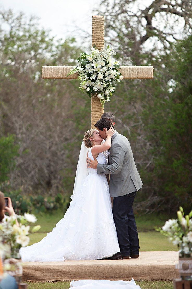 good backdrop idea for those who want a religious ceremony but an outdoor one too | Everest Road Photography  Read more - http://www.stylemepretty.com/texas-weddings/2013/08/06/amazing-race-wedding-from-everest-road-photography/