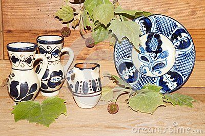 Romanian ceramics and sycamore leaves on wooden background