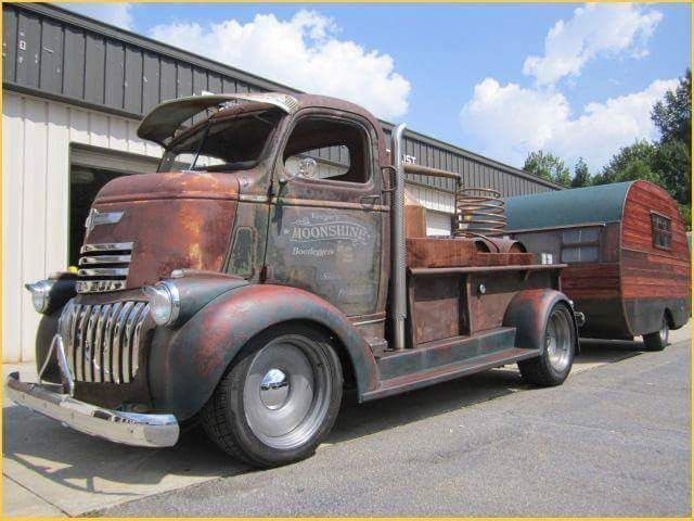 Chevy COE with a custom bed and pulling a vintage trailer