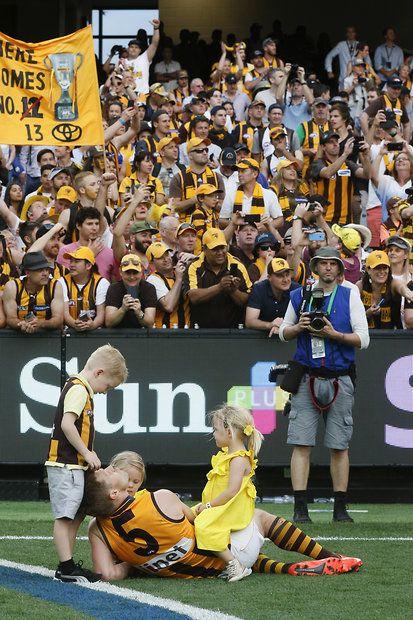 2015 Toyota AFL Grand Final - Hawthorn v West Coast -Hawthorn's Sam Mitchell enjoys a moment with his children