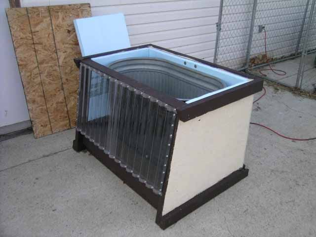 DIY - Solar stock tank keeps water from freezing solid in the winter. I figure if it works in Alberta it has to work here. Putting this on my list of things to make too.