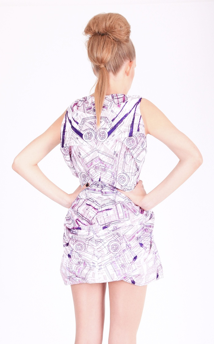 """Back view: Dress ( printed satin, """"Fiat 126p"""" pattern), shoes ( leather, stainless-steel heel)"""