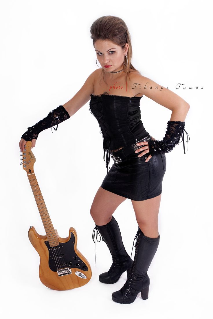 Metal lady. young sexy girl with electric guitar