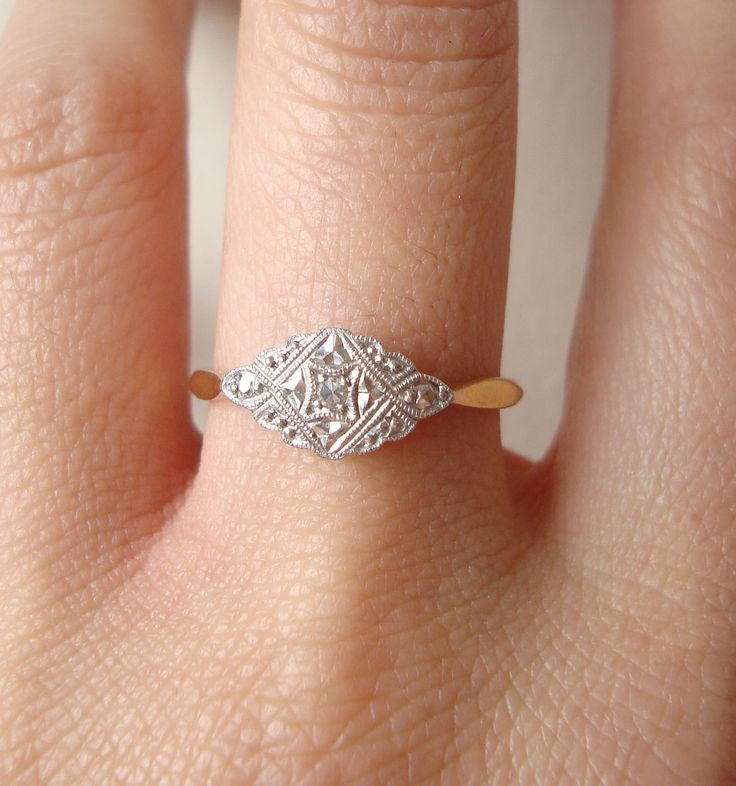 I kind of love how antique engagement rings are more about style and originality than size of rock.