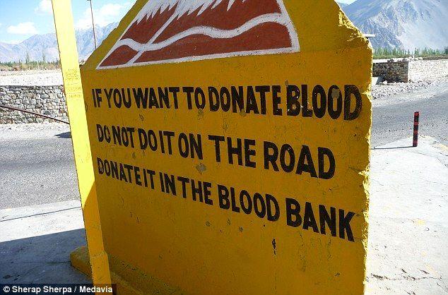 Interesting road signs on dangerous Leh-Manili highway in Himalayas, India - HitFull.com