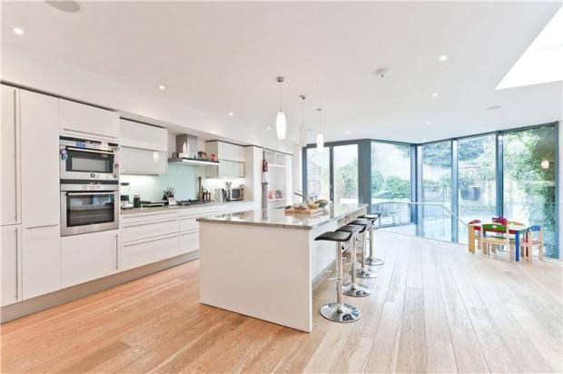 oak floor, white kitchen