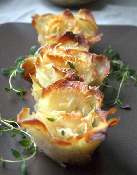Potato Roses (Qty 10) 1.5 kg of potatoes  10 Tbsp of olive oil  10 tsps of grated Parmesan cheese  1 Tbsp chopped thyme,  salt  ~ Cut the potatoes into very thin slices, do not rinse with water. Place in muffin tins in the shape of muffinkowych roses. Add olive and Cheese. Bake for about an hour at 150 ° C. until soft.