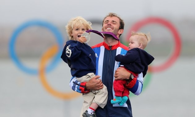 Olympics Day 11 - Sailing-Silver medallist Nick Dempsey of Great Britain celebrates his children Thomas-Flynn (L) and Oscar (R) following the Men's RS:X Sailing on Day 11 of the London 2012 Olympic Games