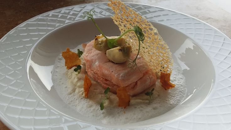 Salmon Medallion with Truffle on Artichokes Velouté with  Foamed Parmesan Milk