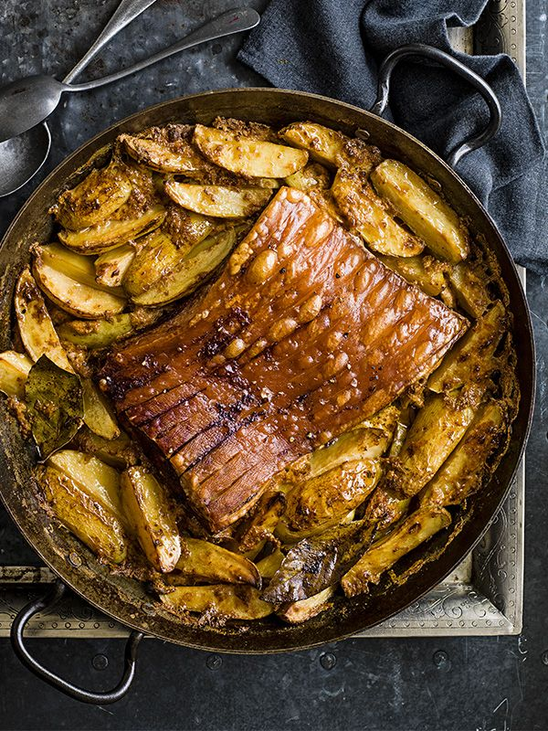This recipe is inspired by an Italian dish which would usually use rolled loin. Pork cooked in milk is tender and succulent – this recipe is more about the meat than the crackling. For optimum crackling, cook for longer at the higher temperature before reducing.