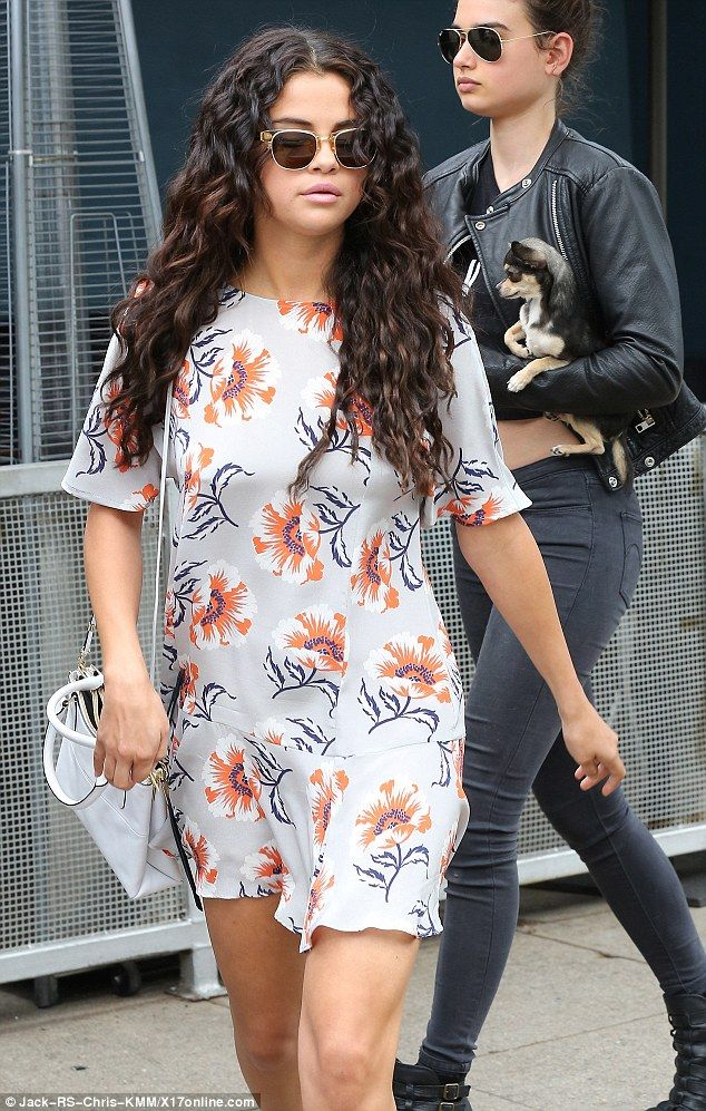 Makeover: The 22-year-old stepped out sporting long wavy locks as she made her way to lunch with friends