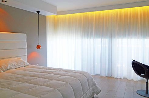 This look is perfect for the day and night. Blackout Roller Shades behind Sheer drapery are ideal for your bedroom. Shadesonline.com