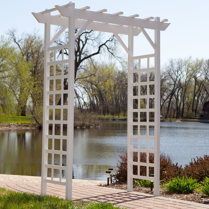 The Dura-Trel Providence 7-ft. Vinyl Pergola Arbor - White will help you to create a charming and welcoming entrance to your yard or garden. This maintenance-free...