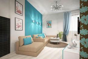 Бежевый диван и бирюзовая стена в интерьере гостиной