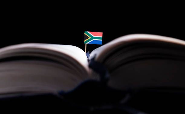 south african flag in the middle of the book knowledge and education