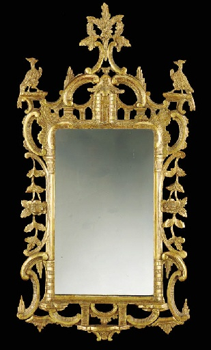 AN IRISH GEORGE II GILTWOOD MIRROR  Circa 1750  With foliate spray cresting raised on C-scrolls and a pagoda flanked by ho-ho birds, the later rectangular plate with a brickwork C-scroll and floral garland hung frame, regilt  55in. (140cm.) high, 29in. (74cm.) wide
