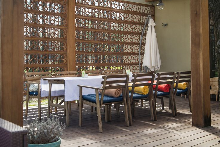 An Exterior application, this dividing wall to this wonderful outdoor seating area has custom Faux Iron Grilles to provide shade and a touch of privacy!