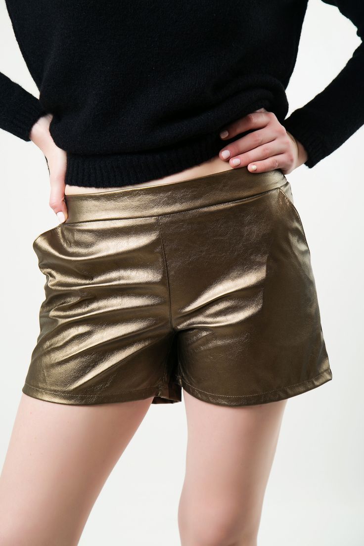 Shorts with back pocket detail. Side pockets. Elastic waist and gathered on the back.  http://www.modaboom.com/clothes/shorts/gold-elastic-shorts/