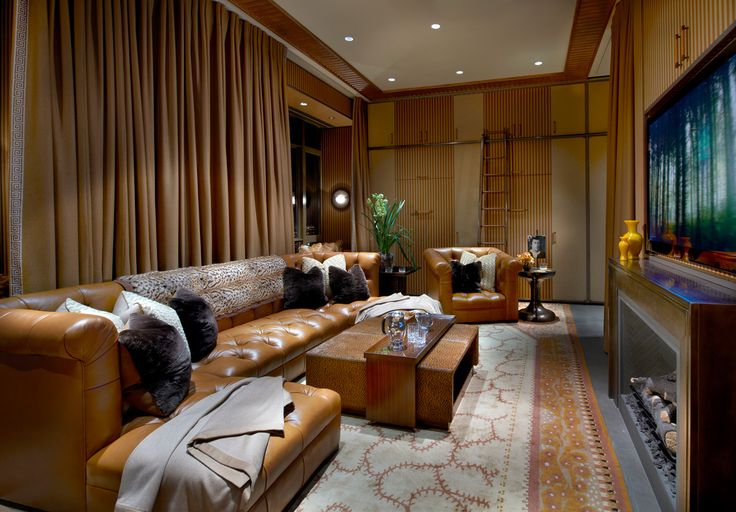 Way to integrate tv above fireplace;Skyline Penthouse - Theater Room_1 - Suzanne Lovell Inc.