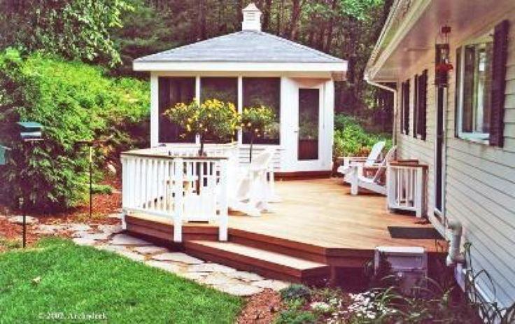 This unique spin on a gazebo and deck combination outdoor living space features a three season gazebo and mahogany deck duo