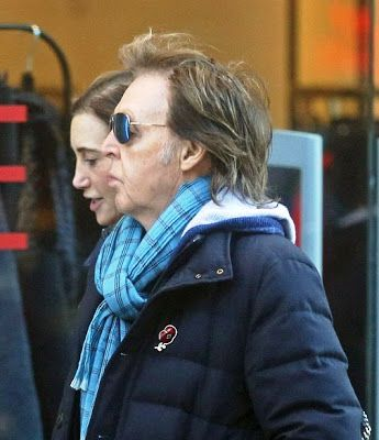 PAUL ON THE RUN: Paul McCartney displays bald patch as he enjoys co...