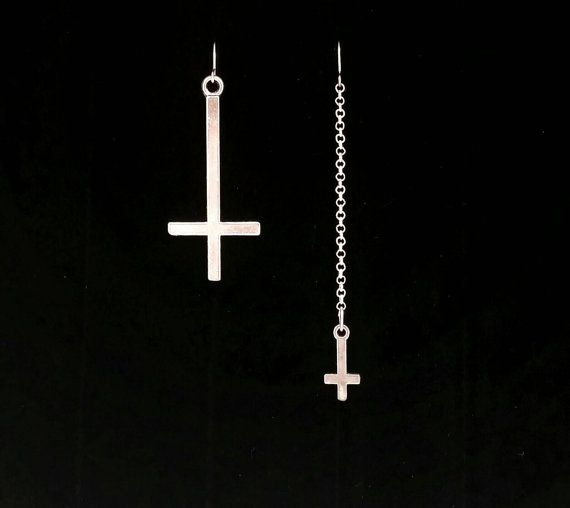 A twist on an unholy classic with 80s style. These are one of my favorite pairs of mismatched earrings.  Asymmetrical inverted cross earrings will make any outfit, whether you're going to dinner or a black metal show. Elegant and kick ass modern gothic jewelry.