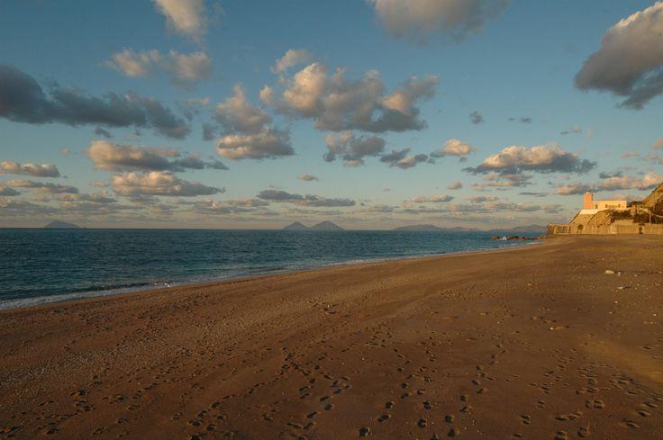 The sandy beach of Capo D'Orlando with the Aeolian Islands behind