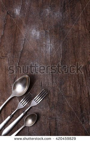 Seasonal old wooden table with cutlery.