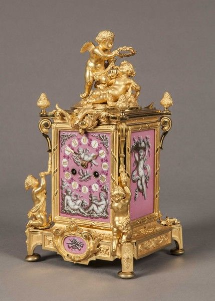An Antique French Gilt and Porcelain Carriage Clock                                                                                                                                                                                 More