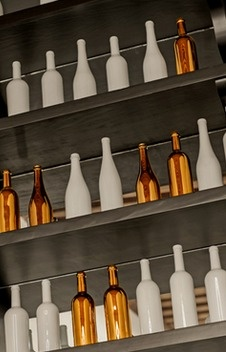 White + gold decorative bottles in a restaurant interior.