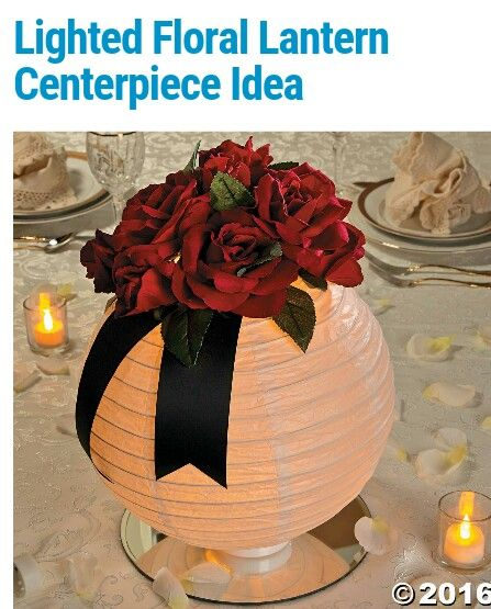 Lantern centerpiece 1. Mirror in center of table  2.place battery operated candle/light in center of mirror 3. Place your choice of color of lantern on top 4. Add flowers to lantern