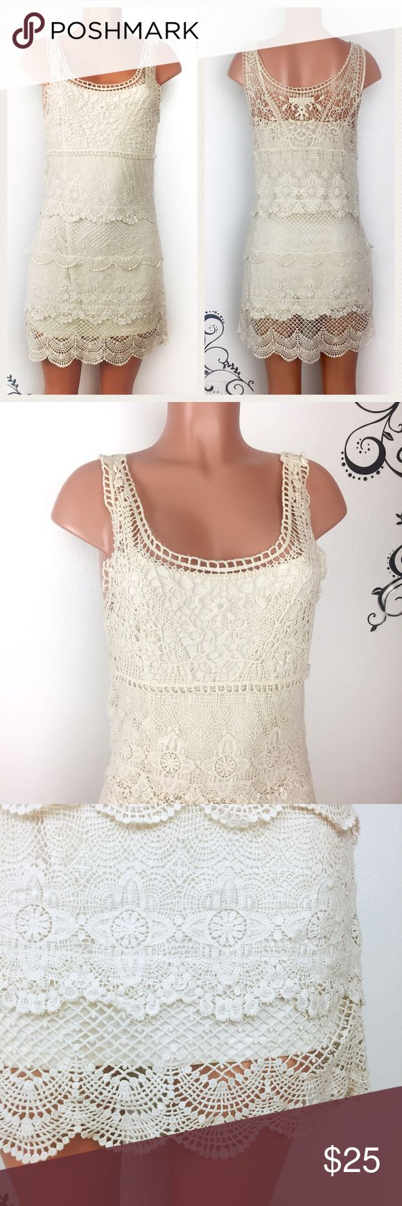 "American Eagle cream beige crochet mini dress Pretty cream beige colored mini dress American Eagle Outfitters.  Great for special occasions and night outs.  Removable slip dress, outer shell can be used as beach over dress too.   Condition: worn a few times, no holes or stains found, in good condition overall  Size: Small Petite Chest: 17 inches across Length: 34.5"" Fabric: cotton  🚫trade, open to offer 🙂 American Eagle Outfitters Dresses Mini"
